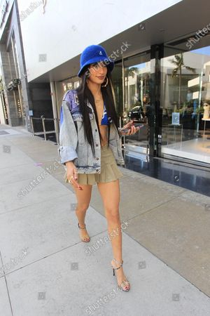 Lexy Panterra seen wearing a jean jacket and a blue brimmed hat
