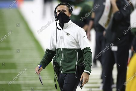 Stock Picture of Green Bay Packers coach Matt LaFleur looks to the scoreboard during the first half of the team's NFL football game against the Detroit Lions in Detroit. LaFleur was the Los Angeles Rams' offensive coordinator in 2017 during the first year of Sean McVay's head coaching tenure after they spent four seasons working together on Mike Shanahan's Washington staff. The Packers and the Rams meet in in a playoff game this weekend