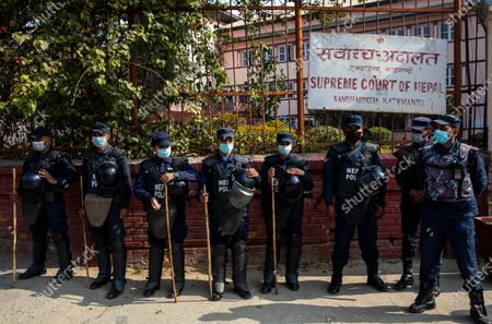 Stock Photo of Nepalese police stand with batons ready during an anti-government protest rally in Kathmandu, Nepal, 13 January 2021. The full bench of constitutional court started hearing the petitions against the dissolution of parliament at the Supreme Court. President Bidhya Devi Bhandari announced the dissolution of Parliament at the request of K.P. Sharma Oli's cabinet on 20 December 2020.