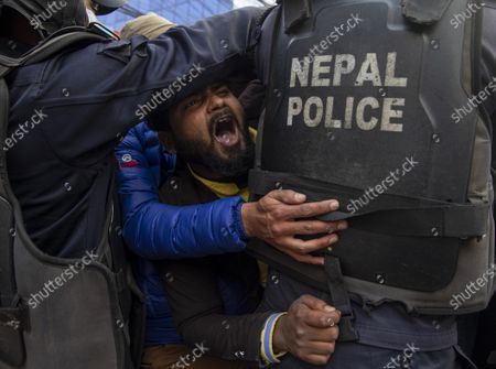 Nepalese police arrest activists of the Nepalese Student Union during the protest against dissolution of parliament in Kathmandua, Nepal, 13 January 2021. The full bench of constitutional court started hearing the petitions against the dissolution of parliament at the Supreme Court. President Bidhya Devi Bhandari announced the dissolution of Parliament at the request of K.P. Sharma Oli's cabinet on 20 December 2020.