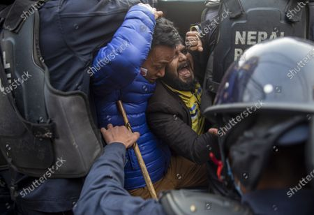 Stock Picture of Nepalese police arrest activists of the Nepalese Student Union during the protest against dissolution of parliament in Kathmandua, Nepal, 13 January 2021. The full bench of constitutional court started hearing the petitions against the dissolution of parliament at the Supreme Court. President Bidhya Devi Bhandari announced the dissolution of Parliament at the request of K.P. Sharma Oli's cabinet on 20 December 2020.