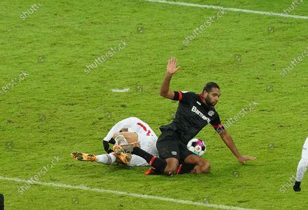 Jonathan Tah (Leverkusen) and Andre Silva (Frankfurt)