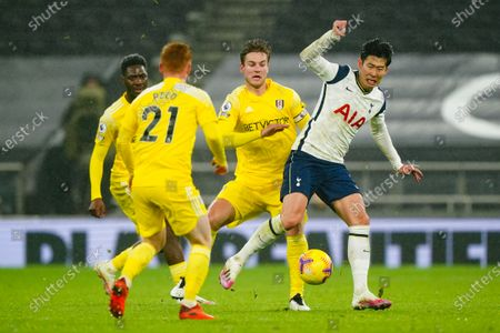 Son Heung-Min of Tottenham Hotspur is challenged by Joachim Andersen of Fulham