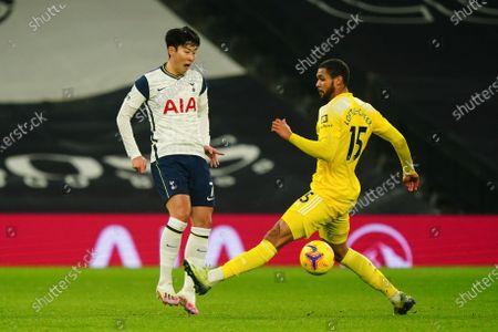 Son Heung-Min of Tottenham Hotspur under pressure from Ruben Loftus-Cheek of Fulham