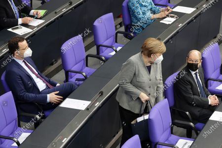 (L-R) German Minister of Health Jens Spahn, German Chancellor Angela Merkel and German Minister of Finance Olaf Scholz during a session of the German parliament 'Bundestag' in Berlin, Germany, 13 January 2021. Members of Bundestag debated on the Coronavirus development among others.