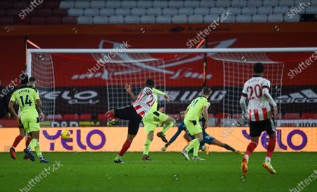 Rhian Brewster of Sheffield United has a shot at goal which hits the posts