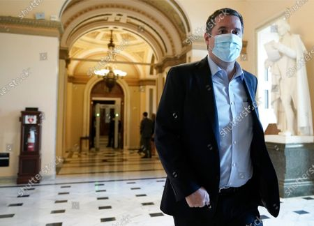Rep. Devin Nunes, R-Calif., walks at the Capitol in Washington, as the House of Representatives pursues an article of impeachment against President Donald Trump for his role in inciting an angry mob to storm the Capitol last week