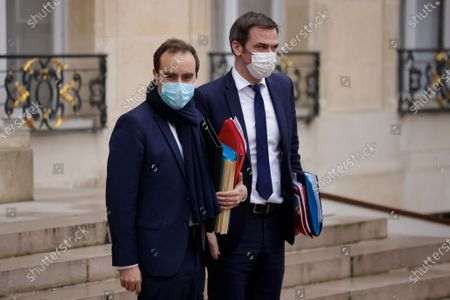 French Overseas Territories Minister Sebastien Lecornu (L) and French Health Minister Olivier Veran (R)  leave the Elysee Palace following the weekly cabinet meeting of the government in Paris, France, 13 January 2021.