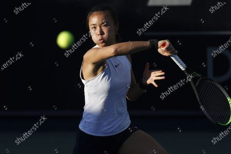 Stock Photo of Yuan Yue of China hits a return during the second round match between Yuan Yue of China and Eugenie Bouchard of Canada at the Australian Open 2021 Women's Singles qualifying in Dubai, United Arab Emirates, Jan. 12, 2021.