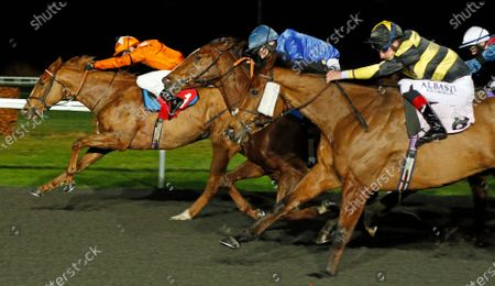 SUNS UP GUNS UP (Charles Bishop) beats TURN OF PHRASE (blue) and BAASHIQ (right) in The Join Racing TV Now Handicap Kempton