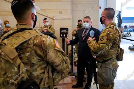 Rep. Chris Smith, R-N.J. speaks to troops inside the Capitol Visitor's Center to reinforce security at the Capitol in Washington, . The House of Representatives is pursuing an article of impeachment against President Donald Trump for his role in inciting an angry mob to storm the Capitol last week