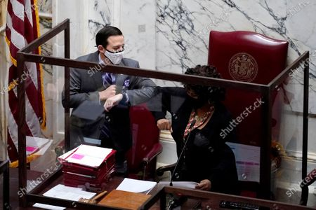 Maryland Senate President Bill Ferguson, D-Baltimore, left, gives an elbow bump to Senate President Pro Tem Melony Griffith, D-Prince George's County, during the first day of the state's 2021 legislative session, in Annapolis, Md