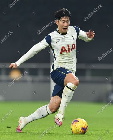 Tottenham's Son Heung-min controls the ball during the English Premier League soccer match between Tottenham Hotspur and Fulham at the Tottenham Hotspur Stadium in London