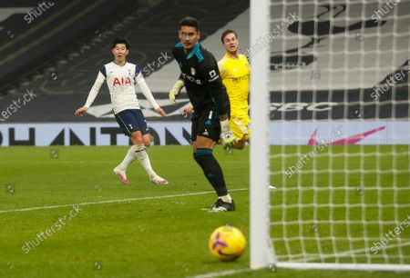 Tottenham's Son Heung-min, left, reacts after missing a chance to score during the English Premier League soccer match between Tottenham Hotspur and Fulham at the Tottenham Hotspur Stadium in London
