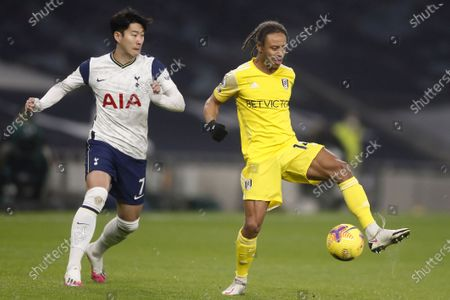 Tottenham's Son Heung-min (L) in action against Fulham's Bobby De Cordova-Reid (R) during the English Premier League soccer match between Tottenham Hotspur and Fulham FC in London, Britain, 13 January 2021.