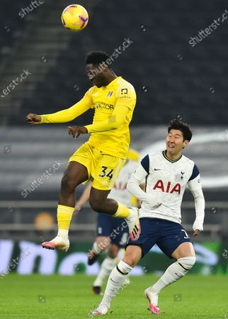 Fulham's Ola Aina (L) in action against Tottenham's Son Heung-min (R) during the English Premier League soccer match between Tottenham Hotspur and Fulham FC in London, Britain, 13 January 2021.