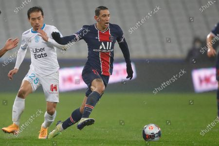 PSG's Angel Di Maria, center, is challenged by Marseille's Yuto Nagatomo during the Champions Trophy soccer match between Paris Saint-Germain and Olympique Marseille at the Bollaert stadium in Lens, northern France, Wednesday, Jan.13, 2021