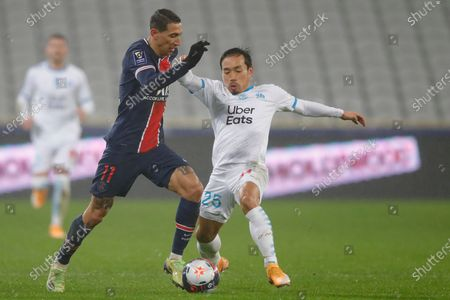 PSG's Angel Di Maria, left, is challenged by Marseille's Yuto Nagatomo during the Champions Trophy soccer match between Paris Saint-Germain and Olympique Marseille at the Bollaert stadium in Lens, northern France, Wednesday, Jan.13, 2021