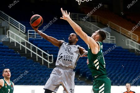 Giorgos Papagiannis (R) of Panathinaikos Opap Athens and Norris Cole of LDLC Asvel Villeurbanne in action during the Euroleague Basketball match between Panathinaikos Opap Athens and LDLC Asvel Villeurbanne at the OAKA Stadium in Athens, Greece, 13 January 2021.