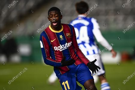 Barcelona's Ousmane Dembele gestures during Spanish Super Cup semi final soccer match between Barcelona and Real Sociedad at Nuevo Arcangel stadium in Cordoba, Spain