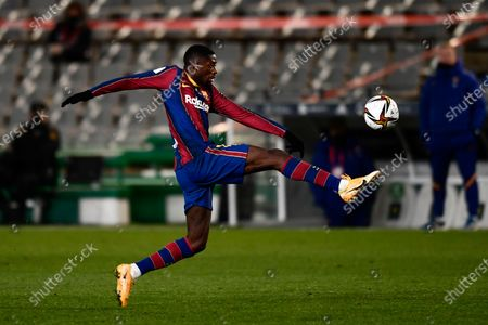 Barcelona's Ousmane Dembele lunges for the ball during Spanish Super Cup semi final soccer match between Barcelona and Real Sociedad at Nuevo Arcangel stadium in Cordoba, Spain