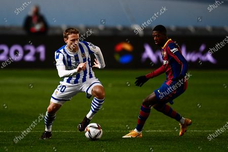 Real Sociedad's Nacho Monreal, left, vies for the ball with Barcelona's Ousmane Dembele during Spanish Super Cup semi final soccer match between Barcelona and Real Sociedad at Nuevo Arcangel stadium in Cordoba, Spain