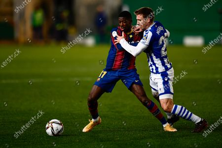 Barcelona's Ousmane Dembele, left, vies for the ball with Real Sociedad's Nacho Monreal during Spanish Super Cup semi final soccer match between Barcelona and Real Sociedad at Nuevo Arcangel stadium in Cordoba, Spain