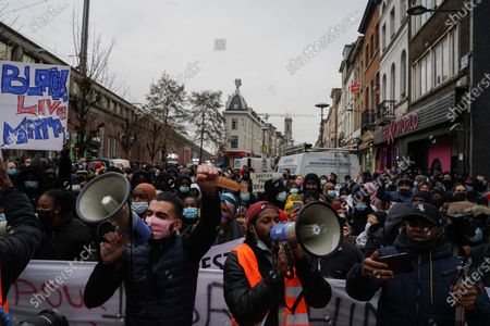 Illustration picture shows a gathering to demand more information on the dead of Ibrahima B., who died last week after a police intervention, taken on Wednesday 13 January 2021 in Brussels. The 23-year-old Ibrahima was arrested last Saturday after fleeing the scene of a Covid-19 control, he was taken to the offices of the Brussels-North zone, where he lost consciousness. He died at the hospital shortly after.