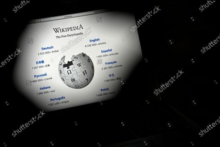Stock Photo of A close-up image shows the front page of the Wikipedia online encyclopedia on a mobile computer, in Cologne, Germany, 13 January 2021. The online encyclopedia Wikipedia was launched on 15 January 2001 by co-founder Jimmy Wales and is now one of the most visited website on the Internet. There are articles in around 300 languages, its service is still non-commercial, and the non-profit organization is financed solely by donations. More than three million volunteers write, edit and check the articles. Wikipedia has become a kind of basic knowledge of the world.