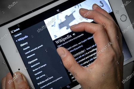 Stock Picture of A close-up image shows a woman using the Wikipedia online encyclopedia on an iPad, in Cologne, Germany, 13 January 2021. The online encyclopedia Wikipedia was launched on 15 January 2001 by co-founder Jimmy Wales and is now one of the most visited website on the Internet. There are articles in around 300 languages, its service is still non-commercial, and the non-profit organization is financed solely by donations. More than three million volunteers write, edit and check the articles. Wikipedia has become a kind of basic knowledge of the world.
