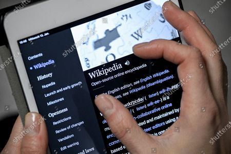 A close-up image shows a woman using the Wikipedia online encyclopedia on an iPad, in Cologne, Germany, 13 January 2021. The online encyclopedia Wikipedia was launched on 15 January 2001 by co-founder Jimmy Wales and is now one of the most visited website on the Internet. There are articles in around 300 languages, its service is still non-commercial, and the non-profit organization is financed solely by donations. More than three million volunteers write, edit and check the articles. Wikipedia has become a kind of basic knowledge of the world.