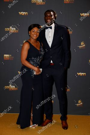 Third placed Genk's Paul Onuachu and his partner Tracy pose for the photographer at the 67th edition of the award ceremony, Wednesday 13 January 2021, at the DPG Media headquarters in Antwerp. The Golden Shoe (Gouden Schoen / Soulier d'Or) is an award for the best soccer player of the Belgian Jupiler Pro League championship during the calender year 2020.