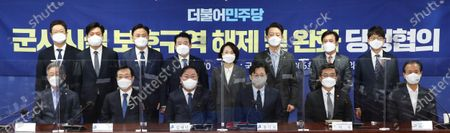Stock Image of (From L to R, front) Gyeonggi Gov. Lee Jae-myung, Min Hong-chul, chief of the parliamentary defense committee, ruling Democratic Party floor leader Kim Tae-nyeon, the party's top policymaker Hong Ihk-pyo, Defense Minister Suh Wook and Gangwon Gov. Choi Moon-soon pose for a photo during a meeting of senior ruling party and government officials at the National Assembly in Seoul, South Korea, 14 January 2021, to discuss lifting or easing a regulation on protected areas near military facilities.