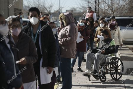 Medical workers wait in line to receive the Pfizer vaccine against COVID-19, on the first day of coronavirus vaccinations in Ciudad Juarez, Mexico