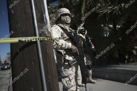 Soldiers stand guard outside General Hospital, one of the locations where medical workers were being given the Pfizer COVID-19, on the first day of coronavirus vaccinations in Ciudad Juarez, Mexico