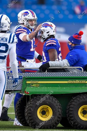 Buffalo Bills running back Zack Moss (20) is consoled by quarterback Josh Allen (17) before being carted off the field with an injury during the second half of an NFL wild-card playoff football game against the Indianapolis Colts, in Orchard Park, N.Y