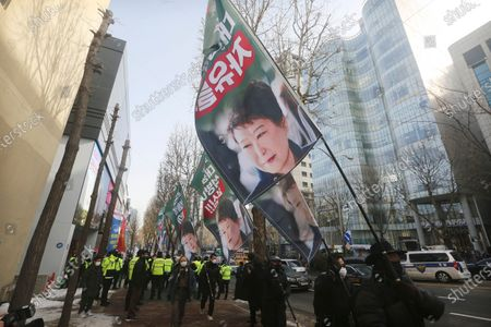 "Supporters of former South Korean President Park Geun-hye march during a rally to call for her release near the Supreme Court in Seoul, South Korea, . South Korea's Supreme Court on Thursday upheld a 20-year prison term for Park over bribery and other crimes as it wrapped up a historic corruption case that marked a striking fall from grace for the country's first female leader and conservative icon. The signs read ""Free"