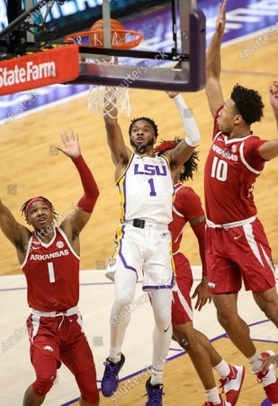 LSU's Javonte Smart (1) puts up a shot over Arkansas' JD Notae (1) and Jaylin Williams (10) during NCAA Basketball action between the Arkansas Razorbacks and the LSU Tigers at the Pete Maravich Assembly Center in Baton Rouge, LA