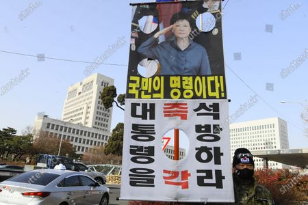 A supporter of former South Korean president Park Geun-hye holds up a banner to call for her release outside the Supreme Court in Seoul, South Korea, 14 January 2021. South Korea's Supreme Court on 14 January upheld the 20-year prison term for former president Park Geun-hye, who was impeached and ousted in 2017 following a corruption scandal.