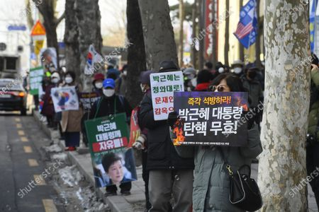 Supporters of former South Korean president Park Geun-hye hold up banners to call for her release outside the Supreme Court in Seoul, South Korea, 14 January 2021. South Korea's Supreme Court on 14 January upheld the 20-year prison term for former president Park Geun-hye, who was impeached and ousted in 2017 following a corruption scandal.