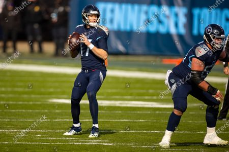 Tennessee Titans quarterback Ryan Tannehill (17) looks to pass against the Baltimore Ravens during the first quarter of an NFL wild-card playoff football game, in Nashville, Tenn. Ravens defeat Titans 20-13
