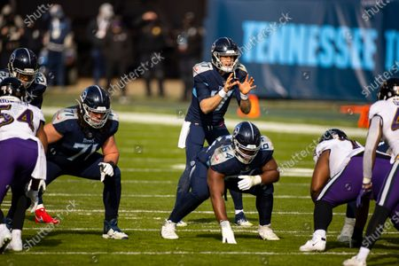 Tennessee Titans quarterback Ryan Tannehill (17) calls for the snap against the Baltimore Ravens during the first quarter of an NFL wild-card playoff football game, in Nashville, Tenn. Ravens defeat Titans 20-13