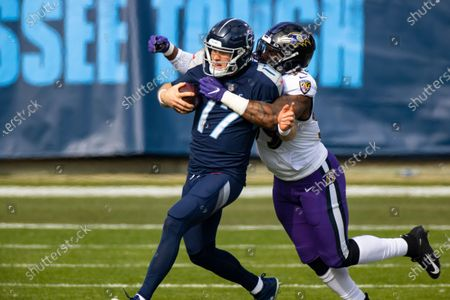 Baltimore Ravens inside linebacker Matt Judon (99) tackles Tennessee Titans quarterback Ryan Tannehill (17) as he runs with the ball during the first quarter of an NFL wild-card playoff football game, in Nashville, Tenn. Ravens defeat Titans 20-13