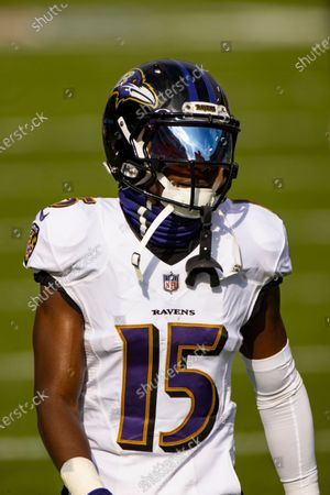 Baltimore Ravens wide receiver Marquise Brown (15) warms up before an NFL wild-card playoff football game against the Tennessee Titans, in Nashville, Tenn
