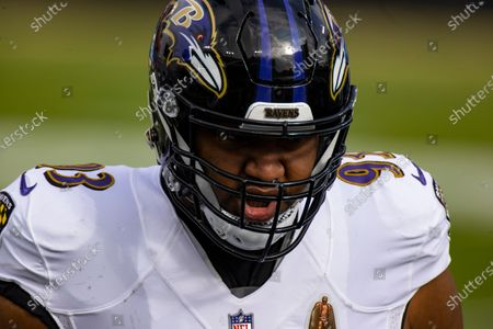 Baltimore Ravens defensive end Calais Campbell (93) warms up before an NFL wild-card playoff football game against the Tennessee Titans, in Nashville, Tenn