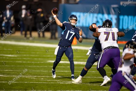 Tennessee Titans quarterback Ryan Tannehill (17) passes the ball against the Baltimore Ravens during the first quarter of an NFL wild-card playoff football game, in Nashville, Tenn. Ravens defeat Titans 20-13
