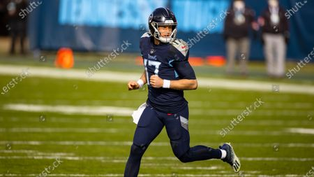 Tennessee Titans quarterback Ryan Tannehill (17) runs after a play against the Baltimore Ravens during the first quarter of an NFL wild-card playoff football game, in Nashville, Tenn. Ravens defeat Titans 20-13