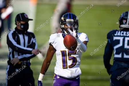 Baltimore Ravens wide receiver Marquise Brown (15) celebrates a first down against the Tennessee Titans during the second quarter an NFL wild-card playoff football game, in Nashville, Tenn. Ravens defeat Titans 20-13