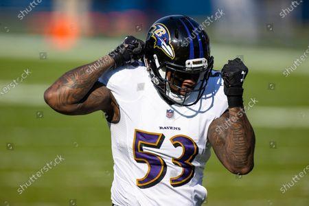 Baltimore Ravens defensive end Jihad Ward (53) celebrates a sack against Tennessee Titans quarterback Ryan Tannehill (17) during the second quarter an NFL wild-card playoff football game, in Nashville, Tenn. Ravens defeat Titans 20-13