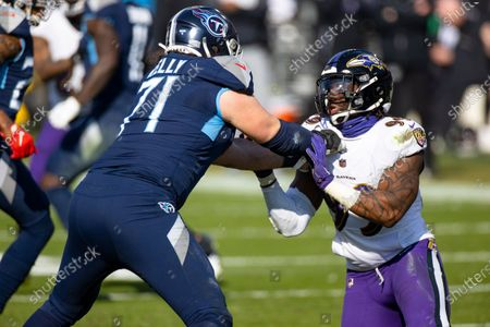 Stock Image of Tennessee Titans offensive tackle Dennis Kelly (71) blocks as Baltimore Ravens inside linebacker Matt Judon (99) rushes during the second quarter of an NFL wild-card playoff football game, in Nashville, Tenn. Ravens defeat Titans 20-13